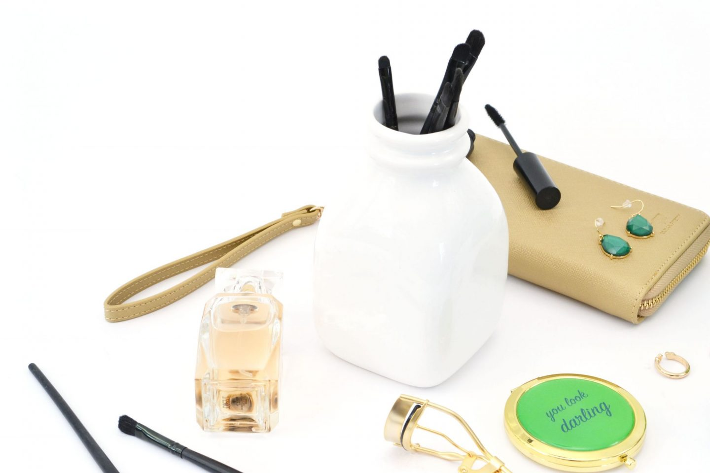 a range of beauty products in gold and green colour theme