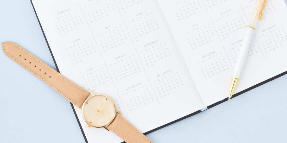 Diary with pen and watch